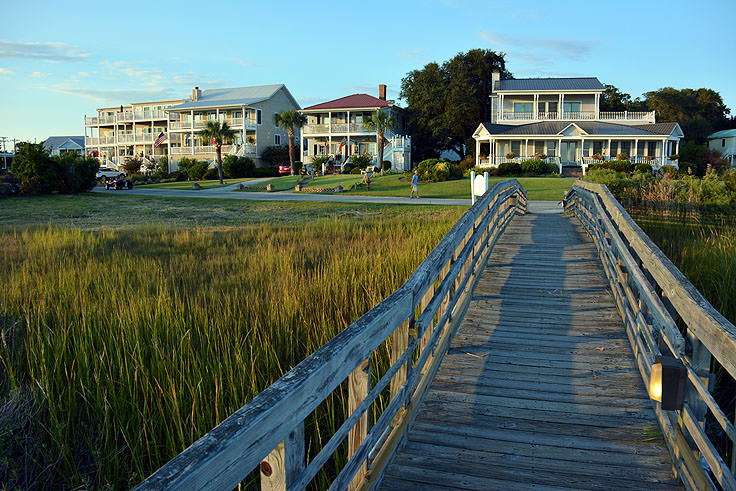 A view of riverfront homes from the Marsh Walk in Southport, NC
