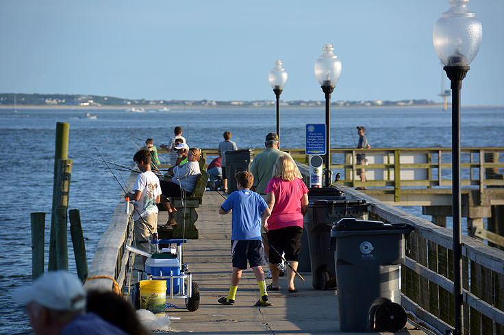 Fishing from city Pier at Waterfront Park in Southport, NC