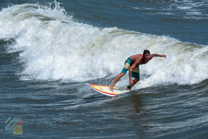 A surfer in Wrightsville Beach