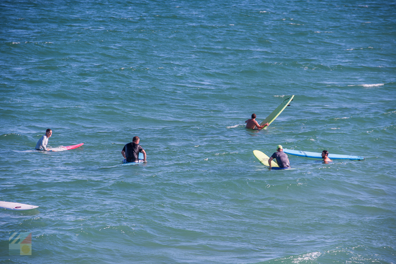 A group surfs in Wrightsville Beach